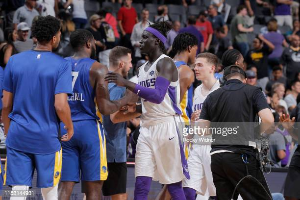 Wenyen Gabriel of Sacramento Kings hifives Golden State Warriors after the game on July 1 2019 at the Golden 1 Center in Phoenix Arizona NOTE TO USER...