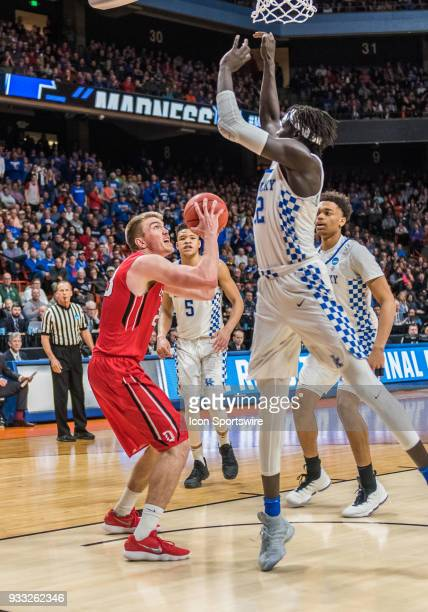 Wenyen Gabriel of the Kentucky Wildcats anticipates the shot by F Peyton Aldridge of the Davidson Wildcats during the NCAA Division I Men's...
