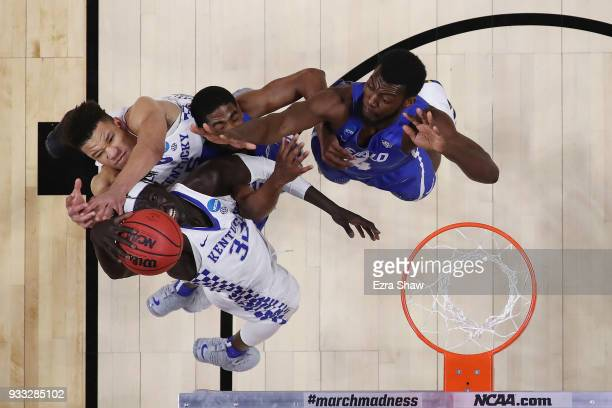 Wenyen Gabriel of the Kentucky Wildcats battles for a rebound against the Buffalo Bulls in the second round of the 2018 NCAA Men's Basketball...