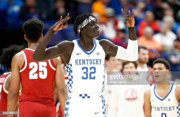 Wenyen Gabriel of the Kentucky Wildcats celebrates after making a three point shot against the Alabama Crimson Tide during the semifinals of the 2018...