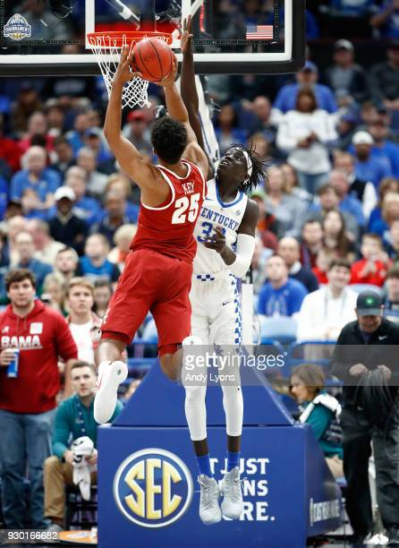 Wenyen Gabriel of the Kentucky Wildcats defends the shot of Braxton Key of the Alabama Crimson Tide during the semifinals of the 2018 SEC Basketball...