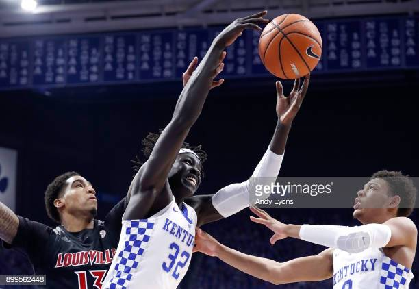 Wenyen Gabriel of the Kentucky Wildcats grabs a rebound against the Louisville Cardinals during the game at Rupp Arena on December 29 2017 in...