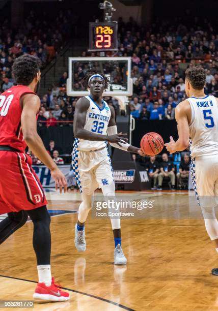 Wenyen Gabriel of the Kentucky Wildcats hands off the ball after bringing it up court during the NCAA Division I Men's Championship First Round game...