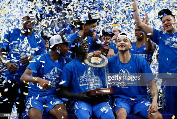 Wenyen Gabriel of the Kentucky Wildcats holds the winner's trophy after the 77-72 win over the Tennessee Volunteers in the Championship game of the...