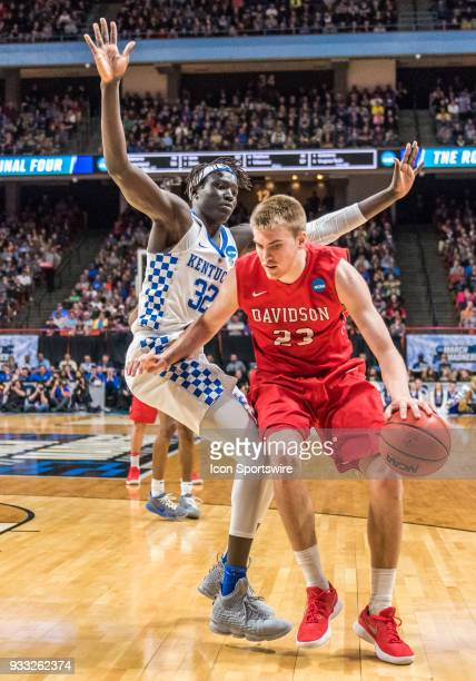 Wenyen Gabriel of the Kentucky Wildcats puts up a block on F Peyton Aldridge of the Davidson Wildcats during the NCAA Division I Men's Championship...