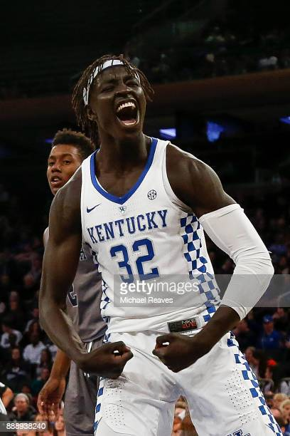Wenyen Gabriel of the Kentucky Wildcats reacts after a dunk against the Monmouth Hawks during the second half at Madison Square Garden on December 9...