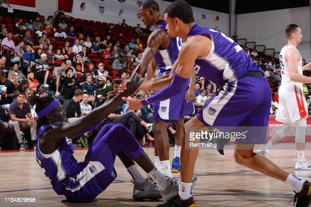 Wenyen Gabriel of the Sacramento Kings is helped up by his teammates during the game against the Houston Rockets on July 9 2019 at the Cox Pavilion...