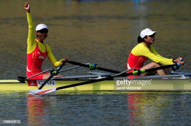 Wenyi Huang and Feihong Pan of China win gold in the Lightweight Women's Double Sculls Final Race A during day six of the 16th Asian Games Guangzhou...