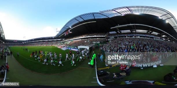 SV Werder Bremen and RB Leipzig teams walk out prior to the Bundesliga match between SV Werder Bremen and RB Leipzig at Weserstadion on April 15 2018...