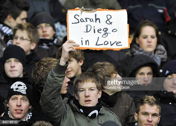 Werder Bremen supporter holds up a sign referring to a possible romance between Werder Bremen's Brazilian midfielder Diego and German singer Sarah...