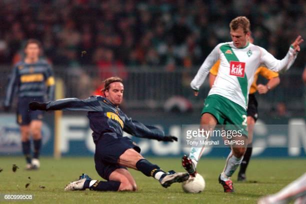 Werder Bremen's Daniel Jensen is tackled by Inter Milan's Andy van der Meyde