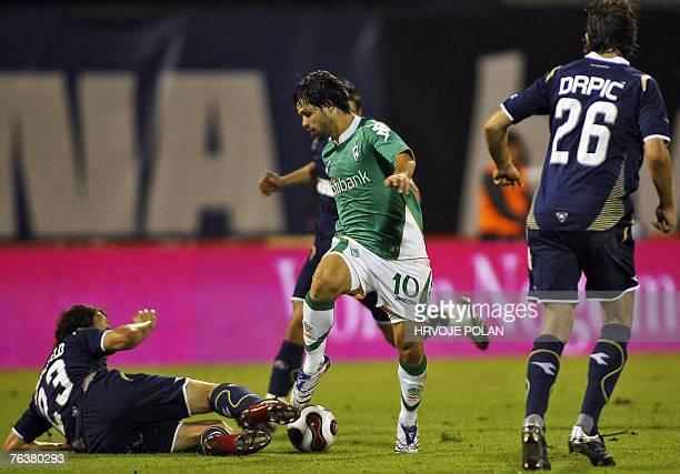 Werder Bremen's Diego vies with Gordon Schildenfeld and Dino Drpic of Dinamo Zagreb during their UEFA Champions League third qualifying round second...