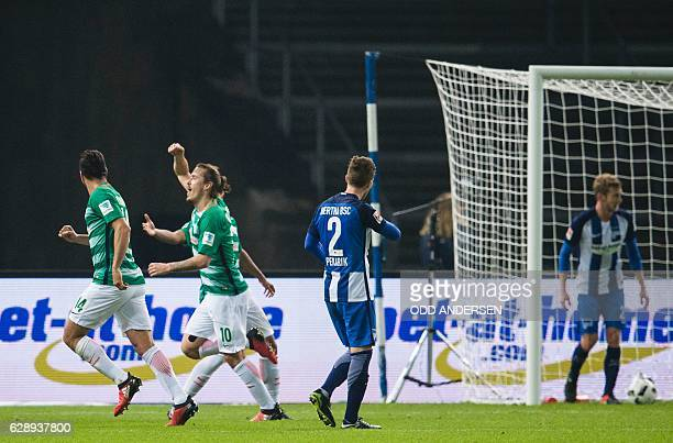 Werder Bremen's forward Max Kruse celebrates scoring the opening goal during the German first division Bundesliga football match between Hertha...