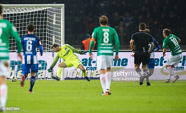 Werder Bremen's forward Max Kruse scores the opening goal during the German first division Bundesliga football match between Hertha Berlin and Werder...