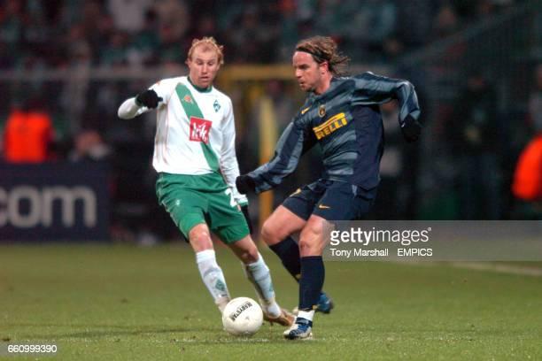 Werder Bremen's Ludovic Magnin and Inter Milan's Andy van der Meyde battle for the ball