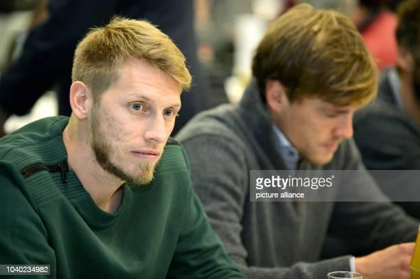 Werder Bremen's players Aaron Hunt and Clemens Fritz attend the general meeting of Bundesliga soccer club Werder Bremen in Bremen Germany 18 November...