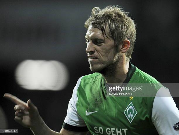 Werder Bremen's striker Aaron Hunt celebrates scoring the 10 during their UEFA Europa League football match Werder Bremen � Athletic Bilbao on...