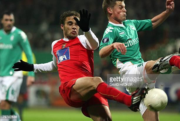 Werder Bremen's Swedish striker Markus Rosenberg vies with Braga's midfielder Frechaut during their UEFA cup group F football match at the...