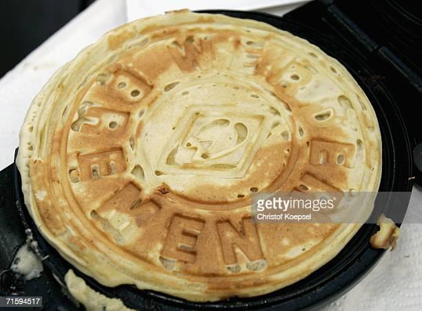Werder waffle is baked during the Werder Bremen Fan Day on August 6 2006 in Bremen Germany