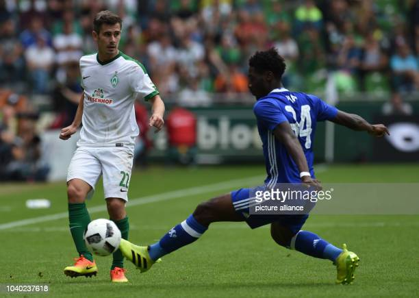 Werder's Fin Bartels vies for the ball with Chelea's Olaf Aina during the test match game between Werder Bremen and FC Chelsea in Bremen Germany 07...
