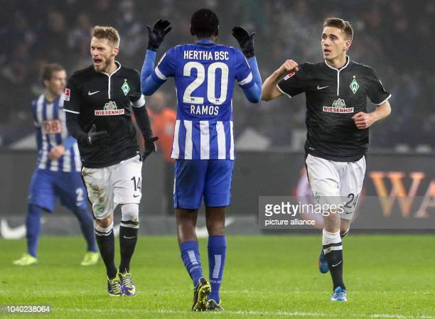 Werder's Nils Petersen celebrates his 22 goal with teammate Aaron Hunt during the Bundesliga soccer match between Hertha BSC and Werder Bremen at the...