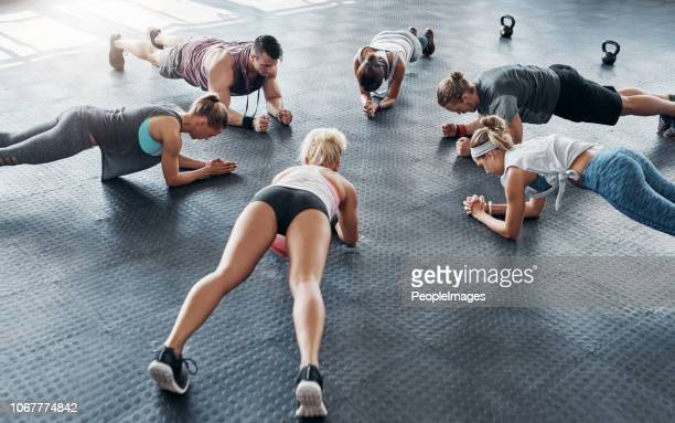 we're all dedicated to fitness - circuit training stock photos and pictures