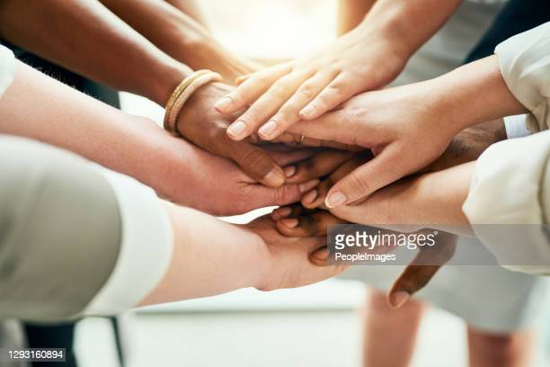 we're all in this together - hands clasped stock pictures, royalty-free photos & images