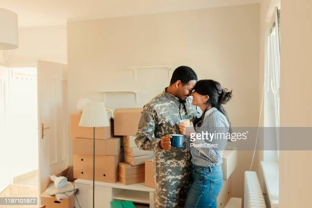 we're enjoying our new home - military spouse stock pictures, royalty-free photos & images