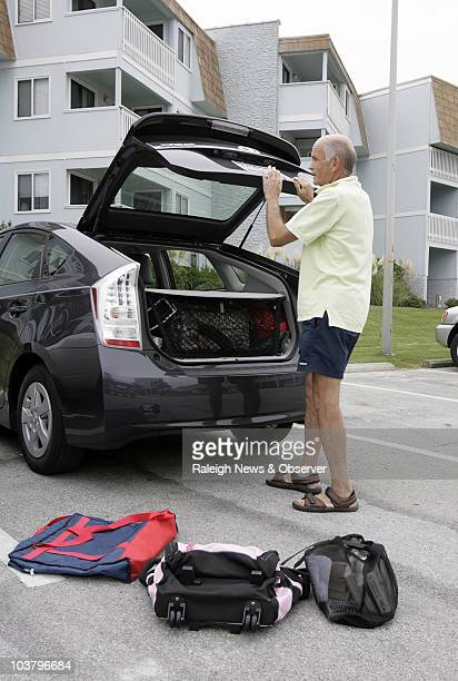 We're evacuating said Jim Monika of Raleigh while he packs up to leave from the place he rented as Hurricane Earl approaches Atlantic Beach North...