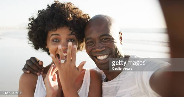 we're getting married! - black women engagement rings stock pictures, royalty-free photos & images