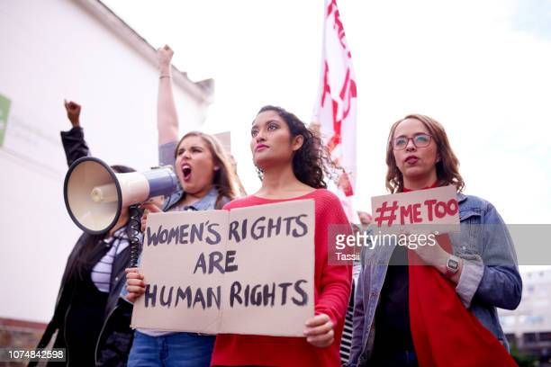 we're in this together as women - marching stock pictures, royalty-free photos & images