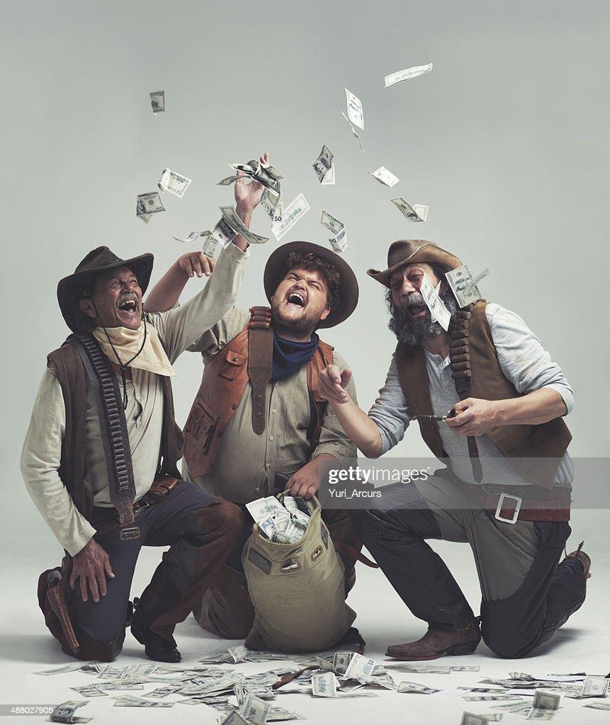 Somos ricos! No más de ganado susurrantes para nosotros. : Foto de stock
