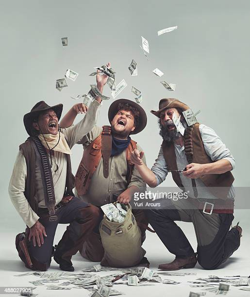 we're rich!! no more cattle rustling for us! - looting stock pictures, royalty-free photos & images
