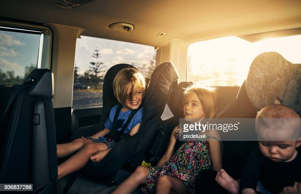 we're so excited to go on an adventure! - family inside car stock photos and pictures