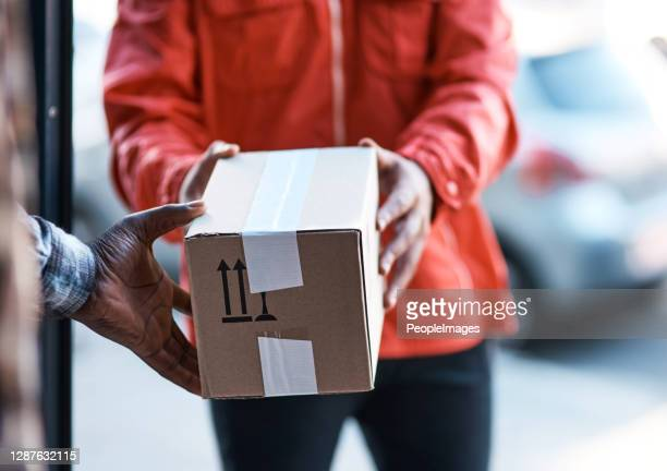 we're the best when it comes to fast delivery - parcel stock pictures, royalty-free photos & images