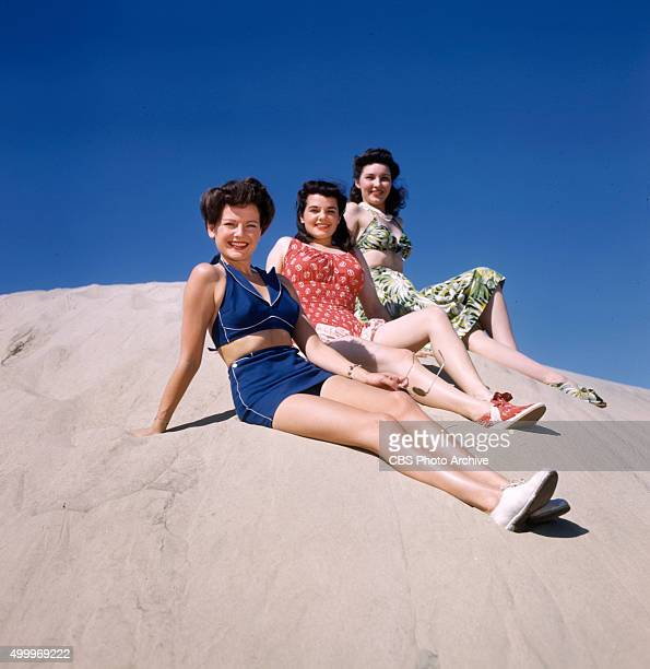 SPRINGS were these three colorful and original models of playclothes worn by CBS starlets Julia Bannon wears a water lily print silk jersey play...