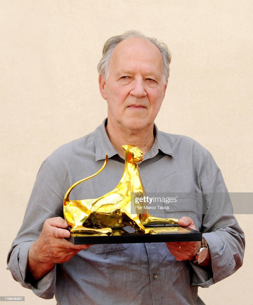Werner Herzog poses with the Pardo of Honor during the 66th Locarno Film Festival on August 15, 2013 in Locarno, Switzerland.