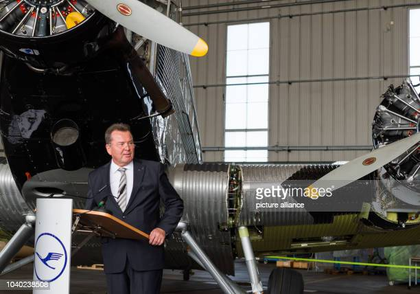 Werner Knorr the CEO of the German Lufthansa Berlin Foundation gives a talk in front of a historic Junkers Ju 52 aircraft in a hangar in Hamburg...
