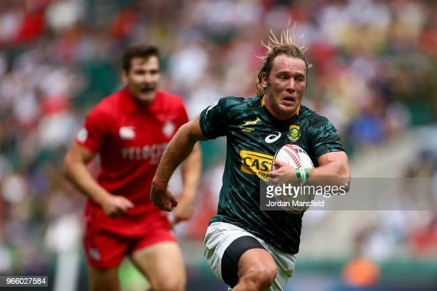 Werner Kok of South Africa breaks free to score a try on day one of the HSBC London Sevens at Twickenham Stadium on June 2 2018 in London United...