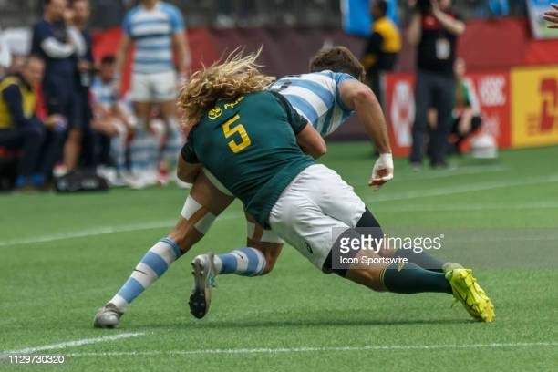 Werner Kok of South Africa brings down Santiago Alvarez of Argentina during Game South Africa 7s vs Argentina 7s in Cup QF matchup at the Canada...