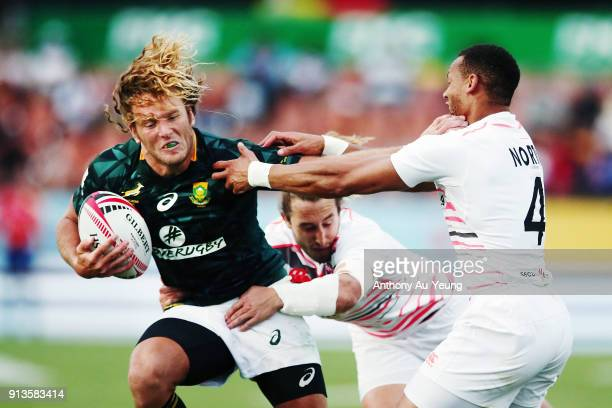 Werner Kok of South Africa fends against Dan Norton of England during the 2018 New Zealand Sevens at FMG Stadium on February 3 2018 in Hamilton New...