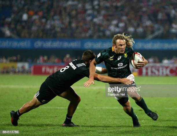 Werner Kok of South Africa is tackled by Andrew Knewstubb of New Zealand during the Cup Final match between South Africa and New Zealand on Day Three...