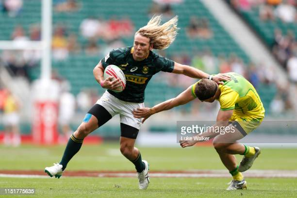 Werner Kok of South Africa is tackled by Joe Pincus of Australia during the South Africa v Australia Challenge Cup Quarter Finals on day two of the...