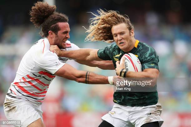 Werner Kok of South Africa is tackled in the game against England during day two of the 2018 Sydney Sevens at Allianz Stadium on January 27 2018 in...