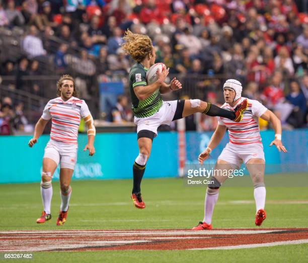 Werner Kok of South Africa jumps and catches the ball ahead of Phil Burgess and Dan Bibby of England during the Cup Final on day 2 of the 2017 Canada...