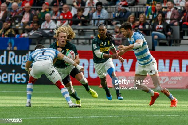 Werner Kok of South Africa tackled by Lautaro Bazan Velez of Argentina during Game South Africa 7s vs Argentina 7s in Cup QF matchup at the Canada...