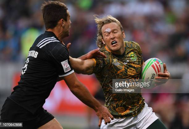 Werner Kok of the South Africa tackled by Andrew Knewstubb of New Zealand during day 2 of the HSBC Cape Town Sevens match 44 Bronze Medal Final match...