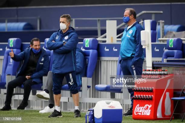 Werner Leuthard, FC Schalke 04 Head of Performance, and Huub Stevens, interim Head Coach of FC Schalke 04 look on prior to the Bundesliga match...