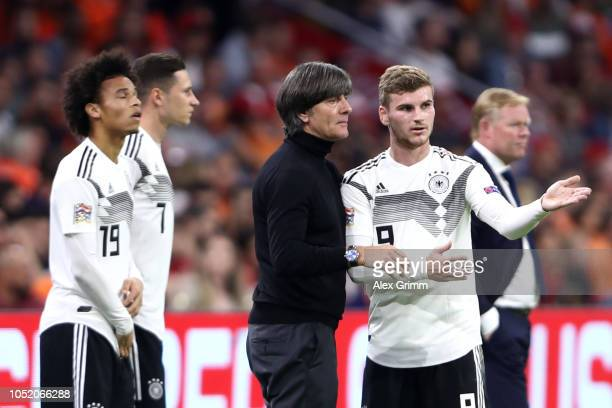 Werner of Germany speaks with Joachim Low Manager of Germany during the UEFA Nations League A group one match between Netherlands and Germany at...