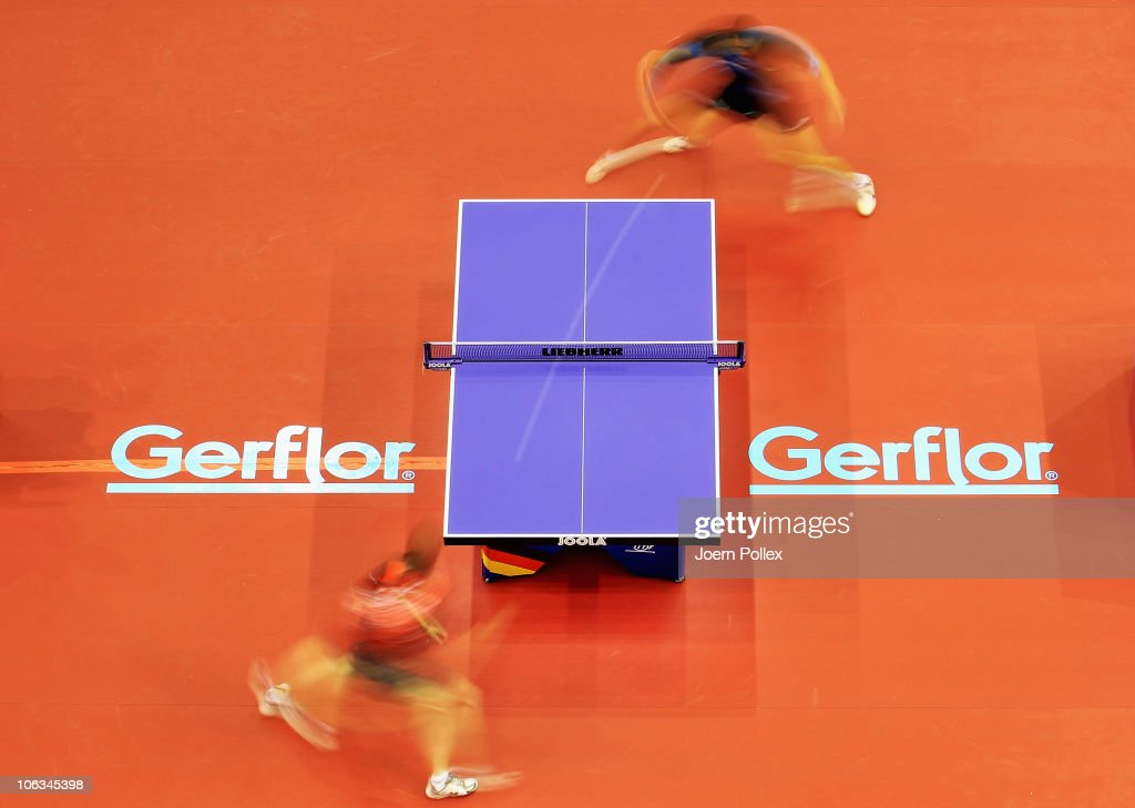 Werner Schlager (top) of Austria and Vladimir Samsonov of Belarus compete during their Table Tennis World Cup 2010 match at the Boerdeland Hall on October 29, 2010 in Magdeburg, Germany.